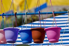 Flowerpot. Flower series: different colour flowerpot on the rope royalty free stock photography
