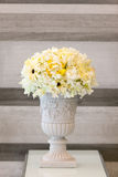 The Flowerpot against stone mable wall. Royalty Free Stock Photos