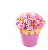 Flowerpot with artificial roses. Pink flowerpot with pink artificial roses. Image isolated over pure white background stock images