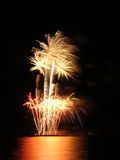 Flowerpot fireworks. Fireworks being shot from a barge in the form of a flowerpot with flowers Stock Photos