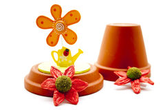Flowerpot with floral decoration Royalty Free Stock Image