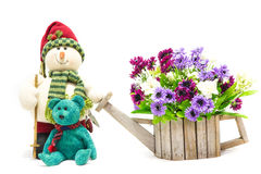 Flowerpot in form of watering can with doll Royalty Free Stock Photo