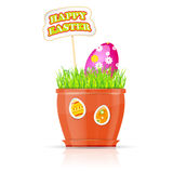 Flowerpot with grass and easter egg Stock Photography