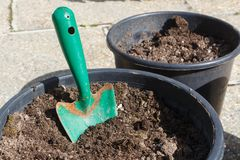 Flowerpot with loam and gardening trowel. Before planting flowers royalty free stock photography