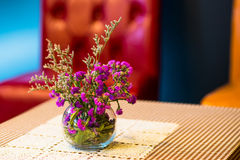 Flowerpot on outdoor table cafe Stock Images