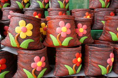 Flowerpot. Reddish brown Plant pot a product handmade. source which locals bring sales to tourists. goods are in Thailand Royalty Free Stock Image