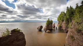 Flowerpot rocks panorama, Hopewell, New Brunswick. Panorama of the flowerpot rock formations at Hopewell Rocks, Bay of Fundy, New Brunswick. The extreme tidal stock images