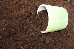 Flowerpot on the soil Stock Images
