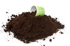 Flowerpot on the top of the pile of soil Royalty Free Stock Images