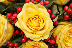 Flowerpot with yellow roses Stock Image