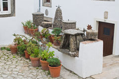Flowerpots and dolmen Stock Image