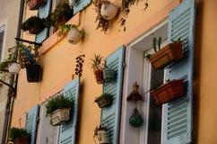 Flowerpots on house Royalty Free Stock Photo