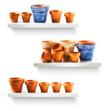 Flowerpots on shelf. Clay flower pots on shelf collection isolated on white backgrounds Stock Images