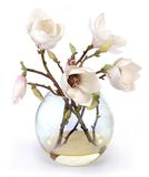 Flowers. Decorative flowers in a glass vase, are used for dressing and an interior ornament Stock Images