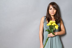 Flowers. Young woman with flowers in her hand Stock Image
