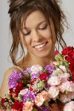 With a flowers. European brunette model with beautiful smile holding flowers Stock Photo