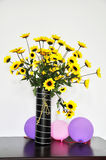 Flowers. And Balloons on the table Royalty Free Stock Image