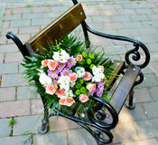 Flowers. Wedding flowers on seat, outdoor Royalty Free Stock Image