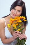 Flowers. Pretty woman with orange flowers stock photo