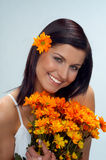 Flowers. Happy woman with orange flower royalty free stock image