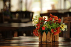 Flowers. On a wood table Royalty Free Stock Photo