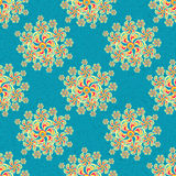 Flowers abstract seamless vector pattern retro style on a blue background Royalty Free Stock Image