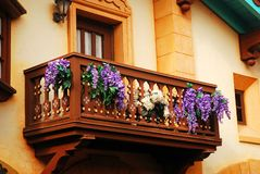 Flowers adorn a balcony. Purple and white flowers adorn a fairy tale like wooden balcony in Florida royalty free stock images