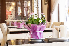 Flowers adorn the table in the restaurant. Stock Image