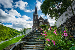 Flowers along a staircase and St. Peters Roman Catholic Church, Royalty Free Stock Images