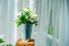 Flowers in aluminum vases are set on crates royalty free stock photos