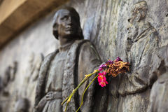 Flowers on arm of Christopher Columbus Monument Royalty Free Stock Photo
