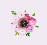 Flowers around red cup of coffee. White and pink wild roses. Flat lay Stock Images
