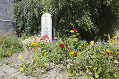 Flowers around the stone in memory of the 13th Lancashire Battalion Royalty Free Stock Image