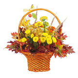 Flowers arrangement centerpiece in wicker basket. Royalty Free Stock Image