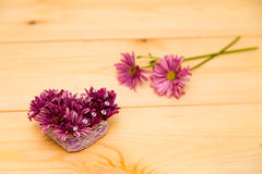 Flowers arrangement with crystals. On wooden background Royalty Free Stock Image