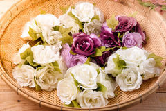 Flowers. Artificial flowers on wooden background Royalty Free Stock Photo