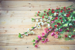 Flowers. Artificial flowers on wooden background Royalty Free Stock Photography
