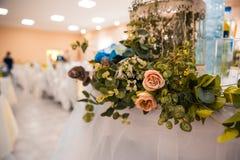 Flowers as decor on the table stock photos