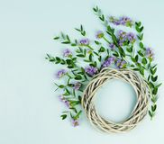 Wreath made of wicker circle, the branches of eucalyptus and purple flowers. Flowers background. Wreath made of wicker circle, the branches of eucalyptus and royalty free stock photos