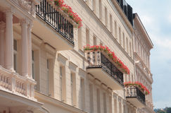 Flowers on balconies. Red flowers on balconies of an old building Royalty Free Stock Photos