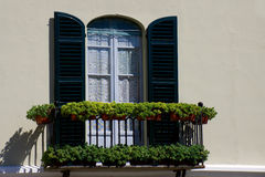 Flowers on a balcony. Interesting colourful balcony in the Italian city - Arona Royalty Free Stock Images