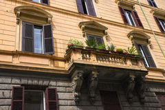 Flowers on the balcony of the beautiful Italian house Royalty Free Stock Image