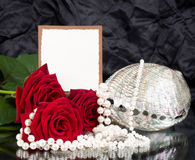 Flowers with banner add and exotic shell. Beautiful red flowers with banner add and exotic shell Royalty Free Stock Images