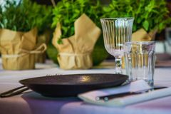 Flowers on a banquet table with empty dishes stock photo
