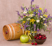 Flowers, barrel, apple and cherry Royalty Free Stock Photos