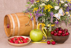 Flowers, barrel, apple and cherry Royalty Free Stock Images