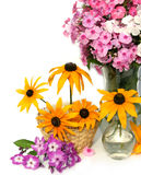 Flowers in a basket. And in vases on a white background Stock Images