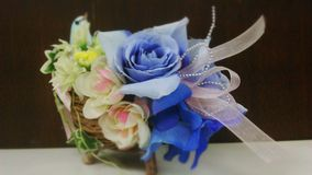 Flowers basket and blue bird Stock Photo