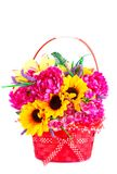Flowers in basket. Colorful fabric flowers in wicker basket isolated on white background Royalty Free Stock Image