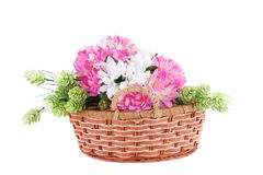 Flowers in basket. Colorful fabric flowers in wicker basket isolated on white background Stock Images